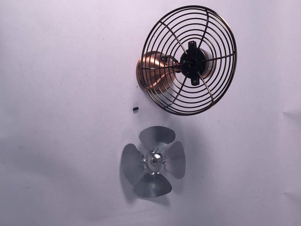 As seen  in the photograph to the left,   The blade of the fan has been removed from its guard