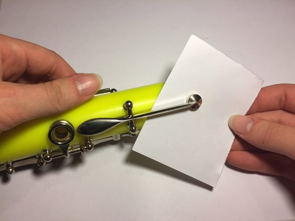 Place a small piece of paper between the key and the instrument to avoid residual glue binding the key to the instrument