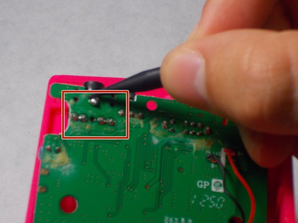 Desolder the 5 points holding the auxiliary port to the motherboard