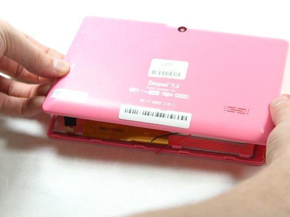 Open the case using a plastic opening tool around the edges. Slightly pull the cover off.