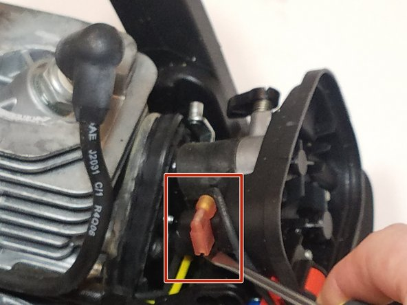 Disconnect the kill switch wire by using a flat head screw driver
