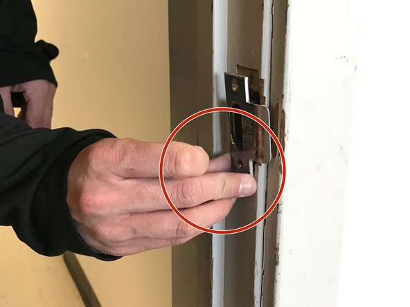 Remove the damaged strike plate from the door frame.