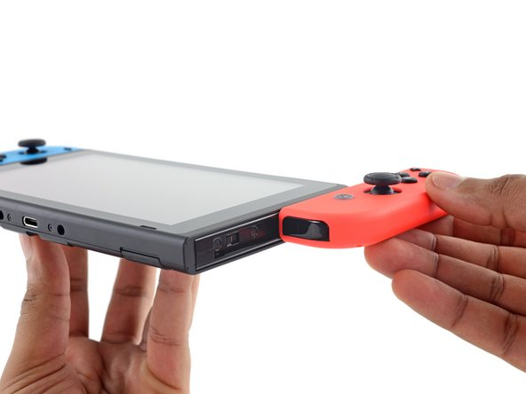 Image 2/3: Despite added functionality, the Joy-Con'd console only weighs 0.88 pounds— less than the 1.1 pound [https://www.ifixit.com/Teardown/Nintendo+Wii+U+Teardown/11796#s42195|new_window=true|Wii U GamePad].