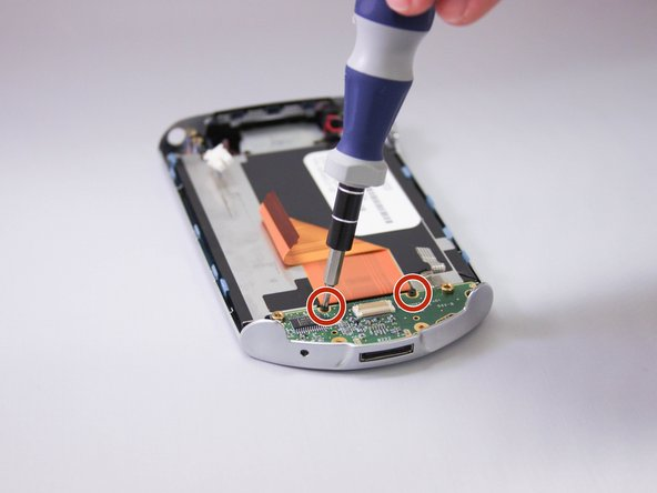 Use 00 Philips screwdriver to remove two screws at bottom of device.