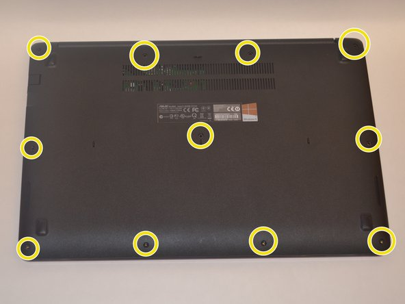 First, use the Phillips #00 Screwdriver to remove the 11 screws on the bottom cover of the laptop.