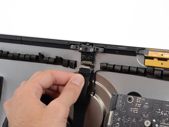 Gently pull the camera cable straight down from its socket on the camera board.