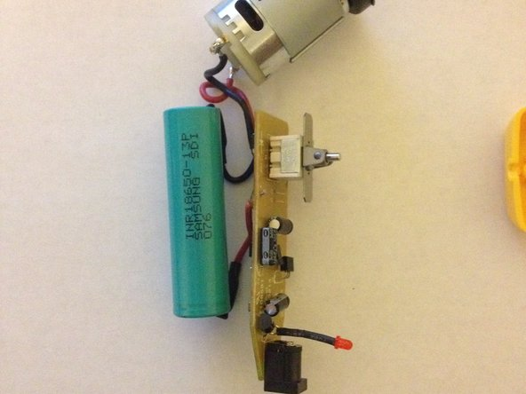 Image 2/2: Remove battery, printed circuit board, LED, and motor assembly from screwdriver casing.