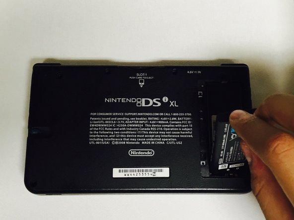 Take the battery off the Dsi Xl.