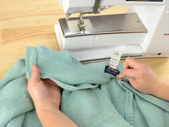 Slide the sleeve over the arm of your sewing machine, just like you'd put the sleeve over your own arm.