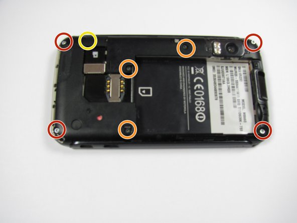 Image 1/3: Remove three 5.5 mm T5 Torx screws from the back of the phone.