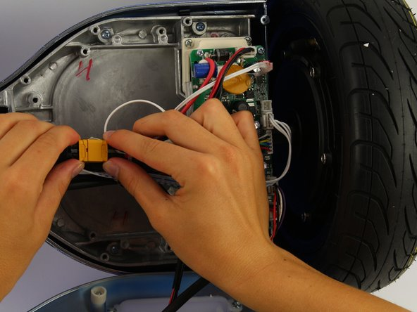 Unplug the battery from the gyroscope by holding the yellow connector and pulling apart.