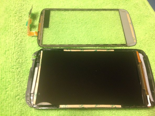 Remove the top layer of sticky black tape, then prep the LCD assembly and new touchscreen/digitizer with new adhesive--I just used thin strips of two-sided tape.