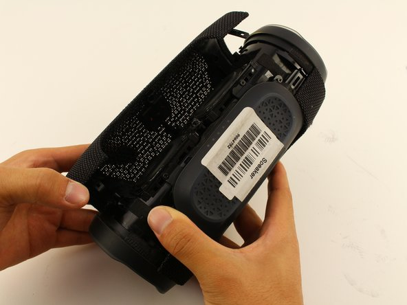 Pull apart your cover gently from both sides and remove it from the speaker housing.