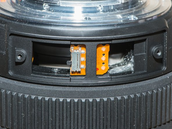 Make sure the interior and exterior zoom switches are in the same position. They must line up when you replace the cover.