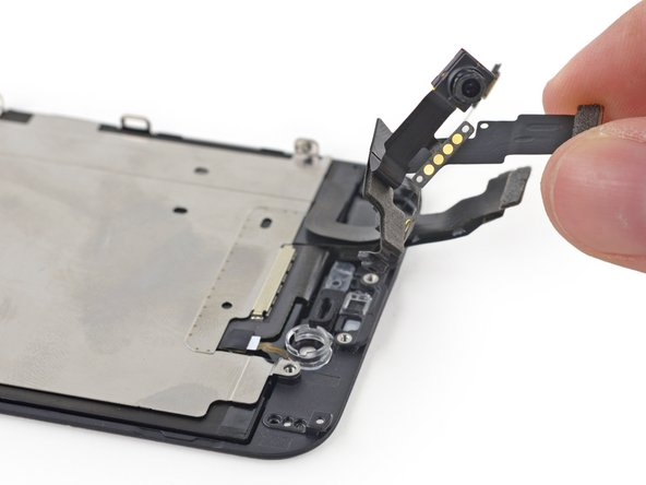 Remove the front-facing camera and sensor cable from the front panel.