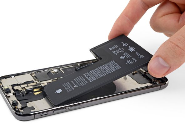 Grasp the battery from the bottom edge and remove it from the iPhone.