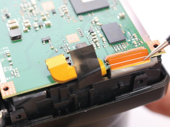 Image 3/3: Pull the ZIF cable from motherboard using tweezers.