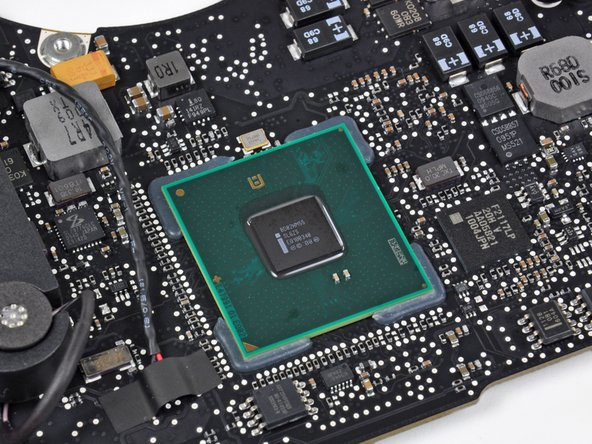 Image 1/1: We assume this chip could be some sort of switch between the Intel and NVIDIA graphics.