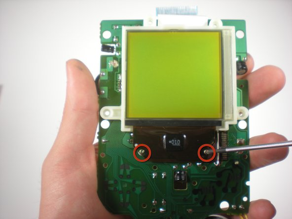 Image 3/3: Remove the two screws connecting the screen and the circuit board.