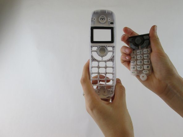 Remove the keypad from the interior of the front casing using a peeling motion.