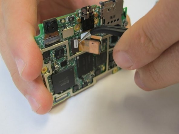 Remove camera from back of the motherboard with tweezers.