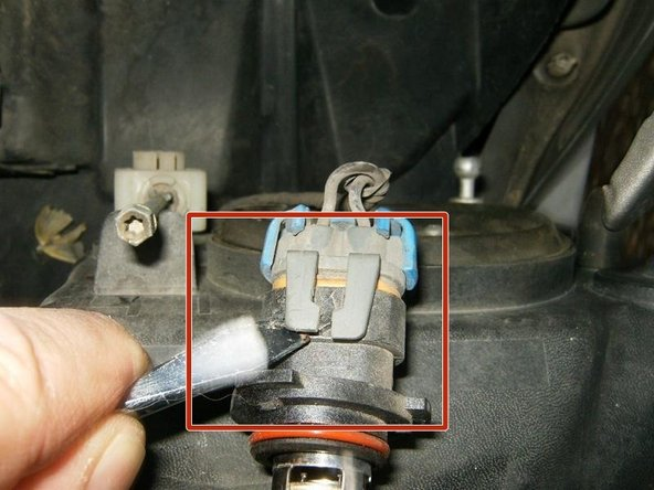 Use a flathead screwdriver (or similar tool) to lift the socket clip of the tab on the bulb and remove the bulb.