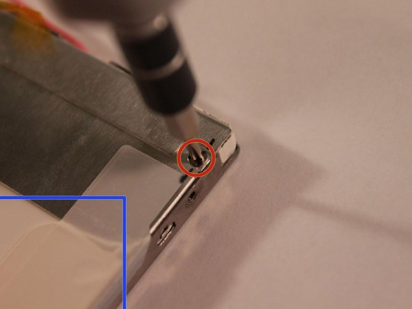 Image 2/2: In addition to removing the screws, remove the tape on the edge of the screen.