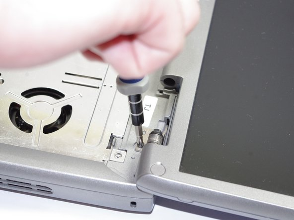 Remove four screws (5.8 mm) located at hinges of the screen.