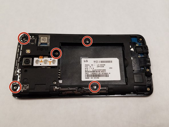 Use a Phillips #0 screwdriver to unscrew the five 3.5 mm screws holding the housing into the device and use a spudger to pop it out of the back of the device exposing the motherboard.