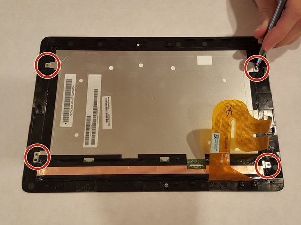 Remove the 4 screws around the metal portion of the screen (this is the LCD display).