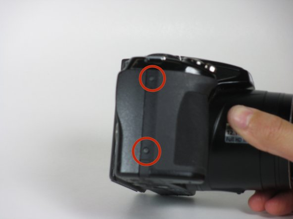 Image 1/3: Remove the two 3mm screws on the grip.