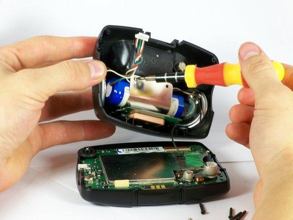 Image 3/3: Remove both screws.