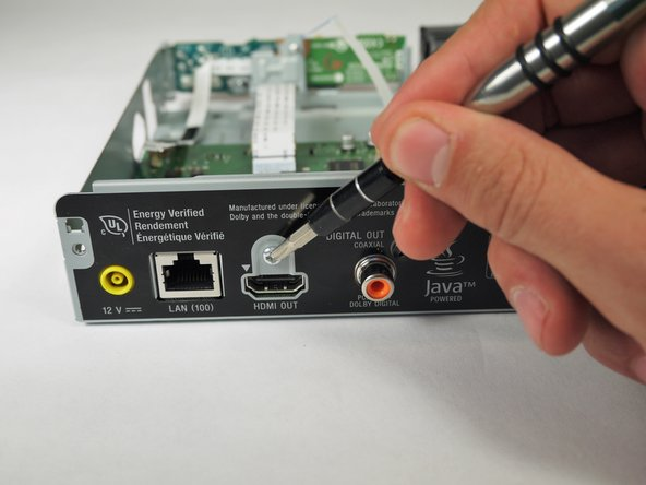 Remove the silver, 5 mm screw above the HDMI port with a PH2 screwdriver bit.