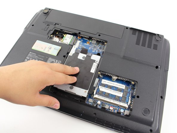 Remove the Hard Drive component from its compartment. To do so, slide the component downward away from the battery pack.