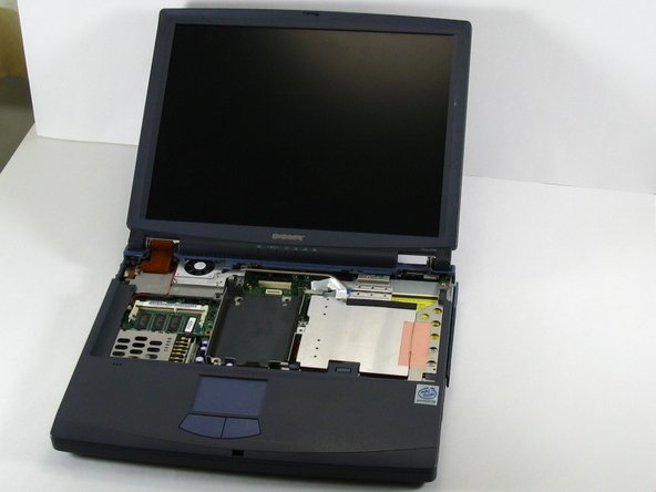With the computer facing you open its lid carefully, so that the computer looks like this.