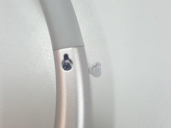 Remove screw using Philips PH00 screwdriver.