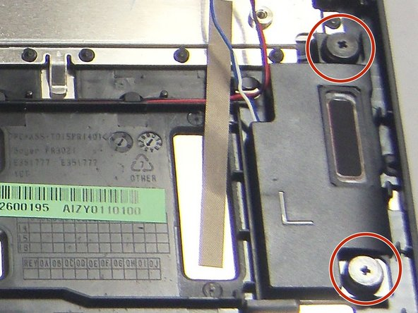 Image 2/3: Remove the two 2 mm Phillips #0 screws securing the right speaker.