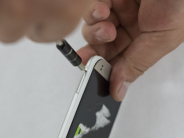 Use the sim eject tool to remove the SIM cards on either side of the phone.