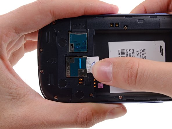 Image 2/3: Grasp and remove the SIM card away from the phone.