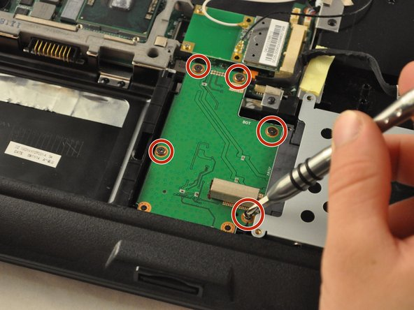 Using the PH1 screwdriver, remove the five .5 mm screws from the SD card reader, located in the bottom-middle corner of the laptop.
