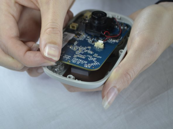 With your fingers, pull the circuit board out of the back casing.