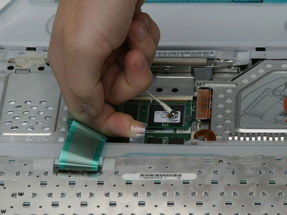 Pull up the keyboard connector cable by its clear plastic loop.