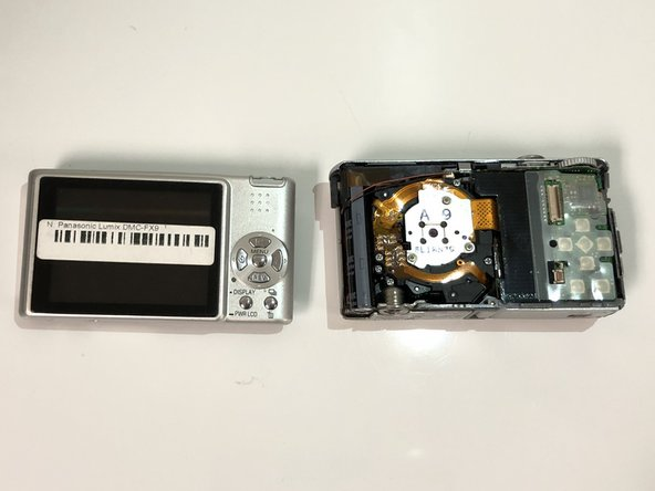 Carefully use the opening tool to remove the LCD Screen from the glass frame.