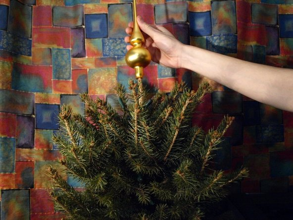 To remove the top ornament, lift it upwards.
