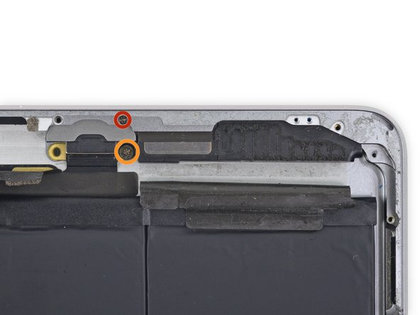 Remove the following Phillips #00 screws securing the left speaker to the rear case: