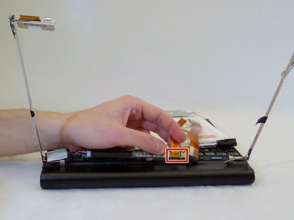 Unplug the orange LCD screen cable from the small circuit board near the laptop keyboard.