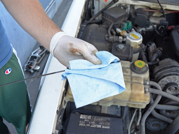 Wipe it down with a towel or rag to remove all the oil and ensure an accurate reading.