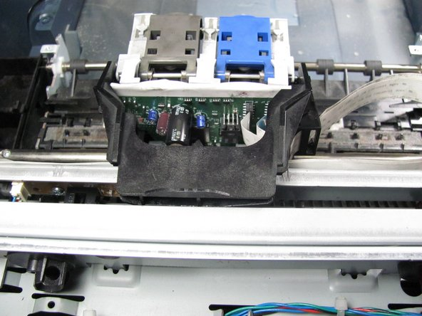 Place new printer carriage on the carriage rod one side at a time.