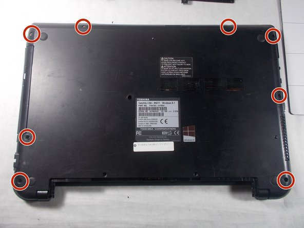 Remove all 6.5 mm Philips head screws on the back cover of the laptop with a Philips #00 screwdriver.