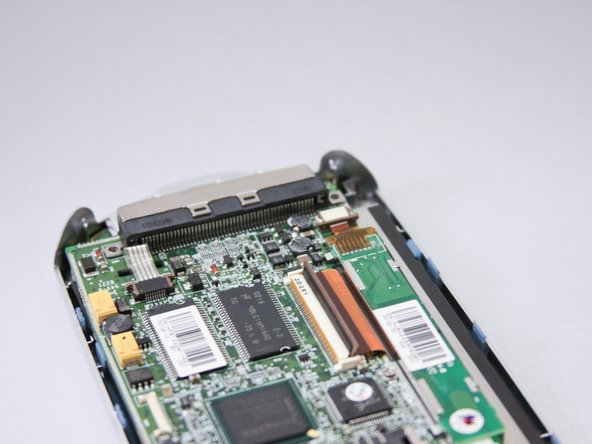 Image 1/1: Use plastic opening tool to carefully remove ribbon cable from connector.